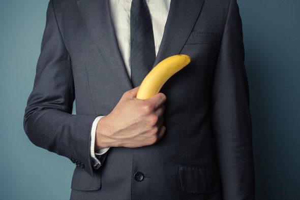 Man in Suit Holding a Banana