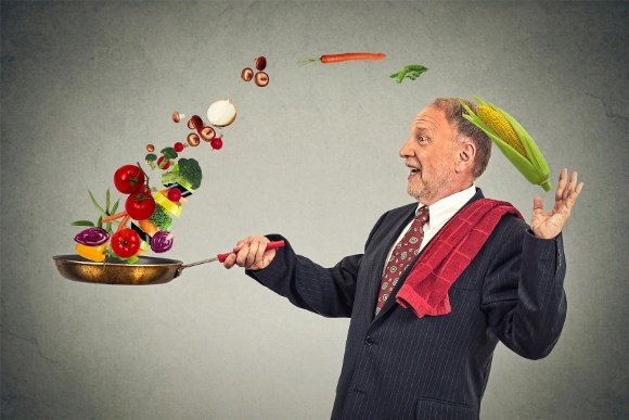 Businessman With Frying Pan Full Of Vegetables
