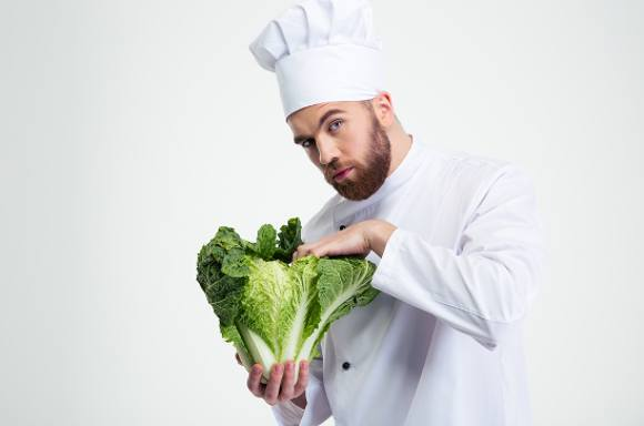 Chef Inspecting Cabbage