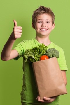 Excited Child Holding Groceries