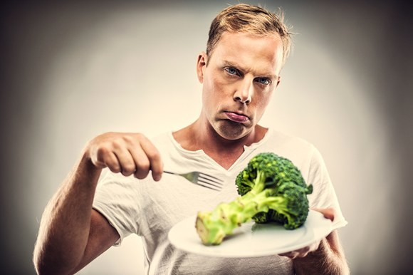 Man With Fork Eating Broccoli