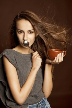 Smug Coffee Drinker With Spoon