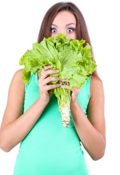 Surprised Woman Holding Leafy Greens