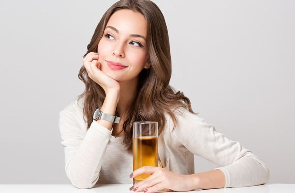 Thinking Woman Holding Glass Of Apple Juice